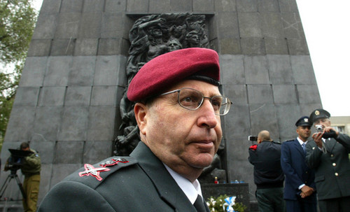 Moshe Yaalon the Chief of Staff of the Israeli army stands in front of the Warsaw Ghetto monument.