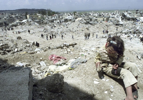 File photo of a Palestinian girl playing in the destroyed Jenin refugee camp