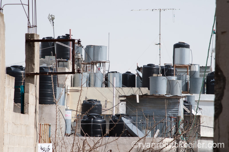 Water tanks on Palestinian rooftops