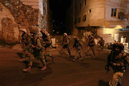Israeli soldiers patrol in the West Bank city of Hebron