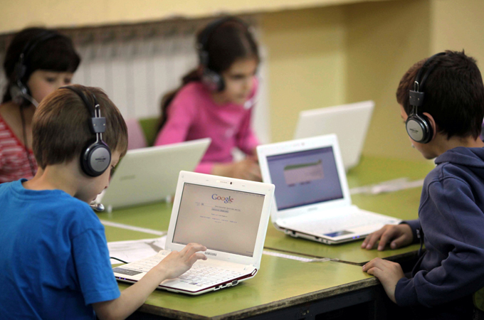 Israeli school kids with computers in Jerusalem