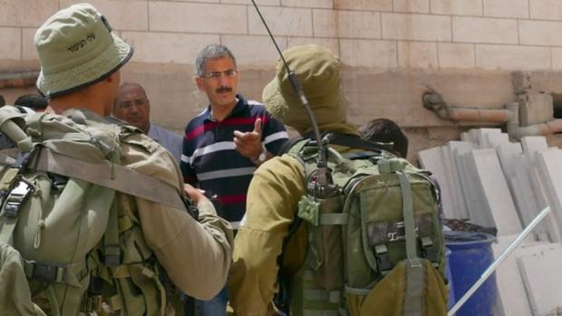 Diviso in due da una strada per soli ebrei, un quartiere palestinese di Hebron sta morendo