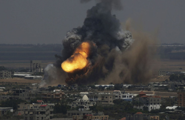 Smoke and flames are seen following what police said was an Israeli air strike in Rafah in the southern Gaza Strip July 8, 2014. Israel bombarded dozens of targets in the Gaza Strip on Tuesday, stepping up what it said might become a long-term offensive against Islamist Hamas after a surge in Palestinian rocket attacks on Israeli towns. REUTERS/Ibraheem Abu Mustafa (GAZA - Tags: POLITICS CIVIL UNREST TPX IMAGES OF THE DAY) ORG XMIT: SJS12